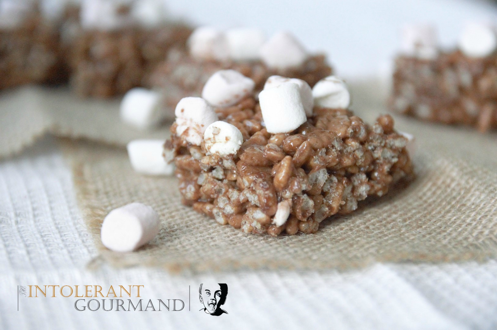 Chocolate marshmallow crispie squares - dairy-free, gluten-free, wheat-free, egg-free, nut-free, vegan and delicious! www.intolerantgourmand.com