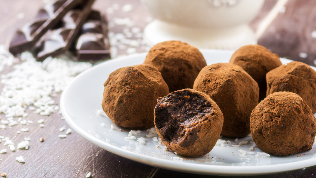 Vegan Chocolate Coconut Truffles - decadent truffles, made with dairy-free chocolate and coconut for the ultimate Valentines Day indulgence. Simply make just because, or for a last minute present! www.intolerantgourmand.com