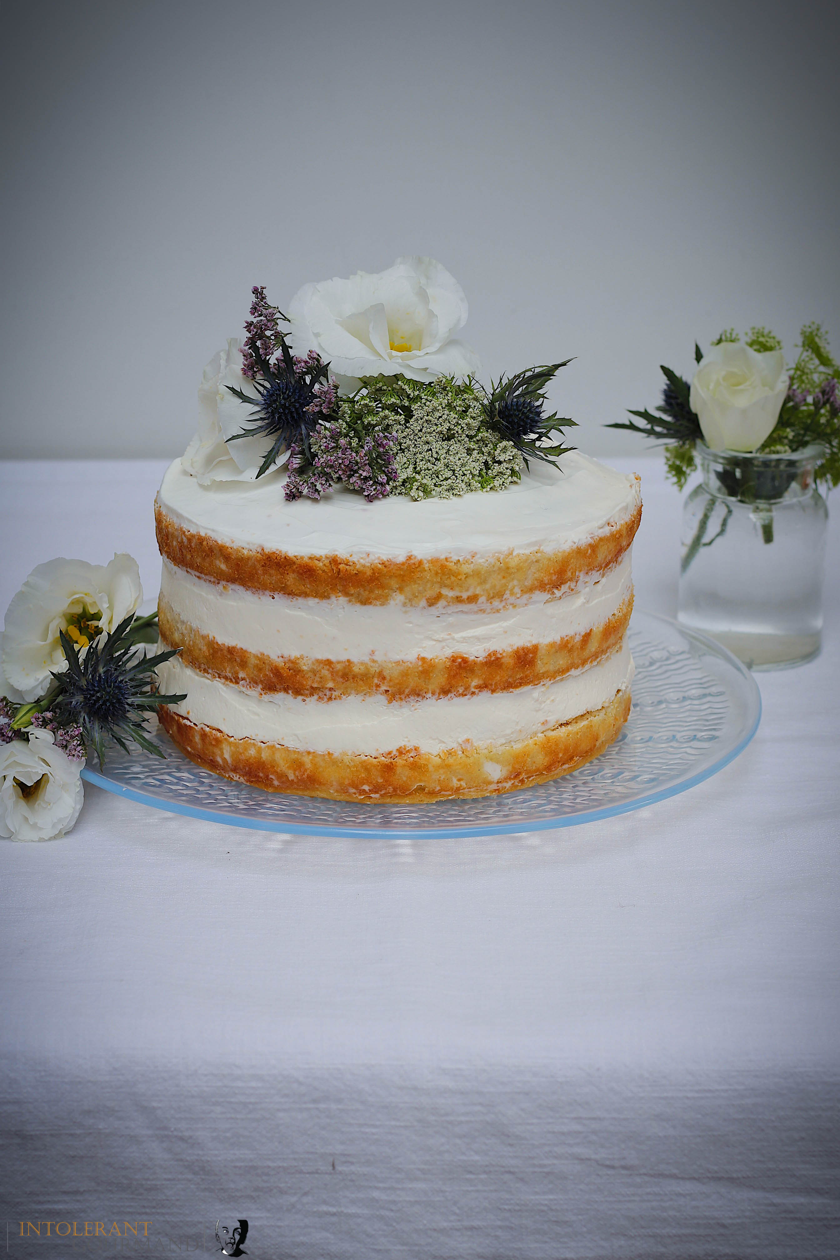 Royal Wedding Cake - Elderflower and lemon cake. A beautiful 3 tiered light and delicate sponge cake, that is gluten-free and dairy-free. Perfect for any celebration, or simply just because! www.intolerantgourmand.com