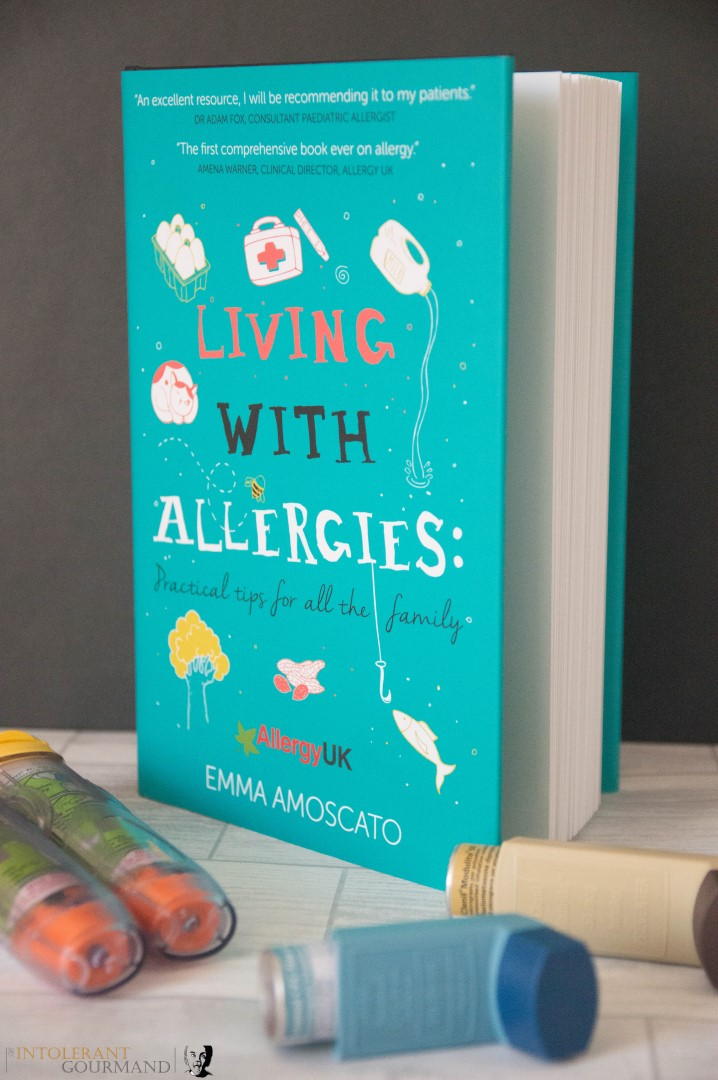 Living with allergies a guide to living and thriving with allergies - everything you need to know in the early days of diagnosis of allergies. Book surrounded by inhaler, epi pens, antihistamines and steroids. www.intolerantgourmand.com