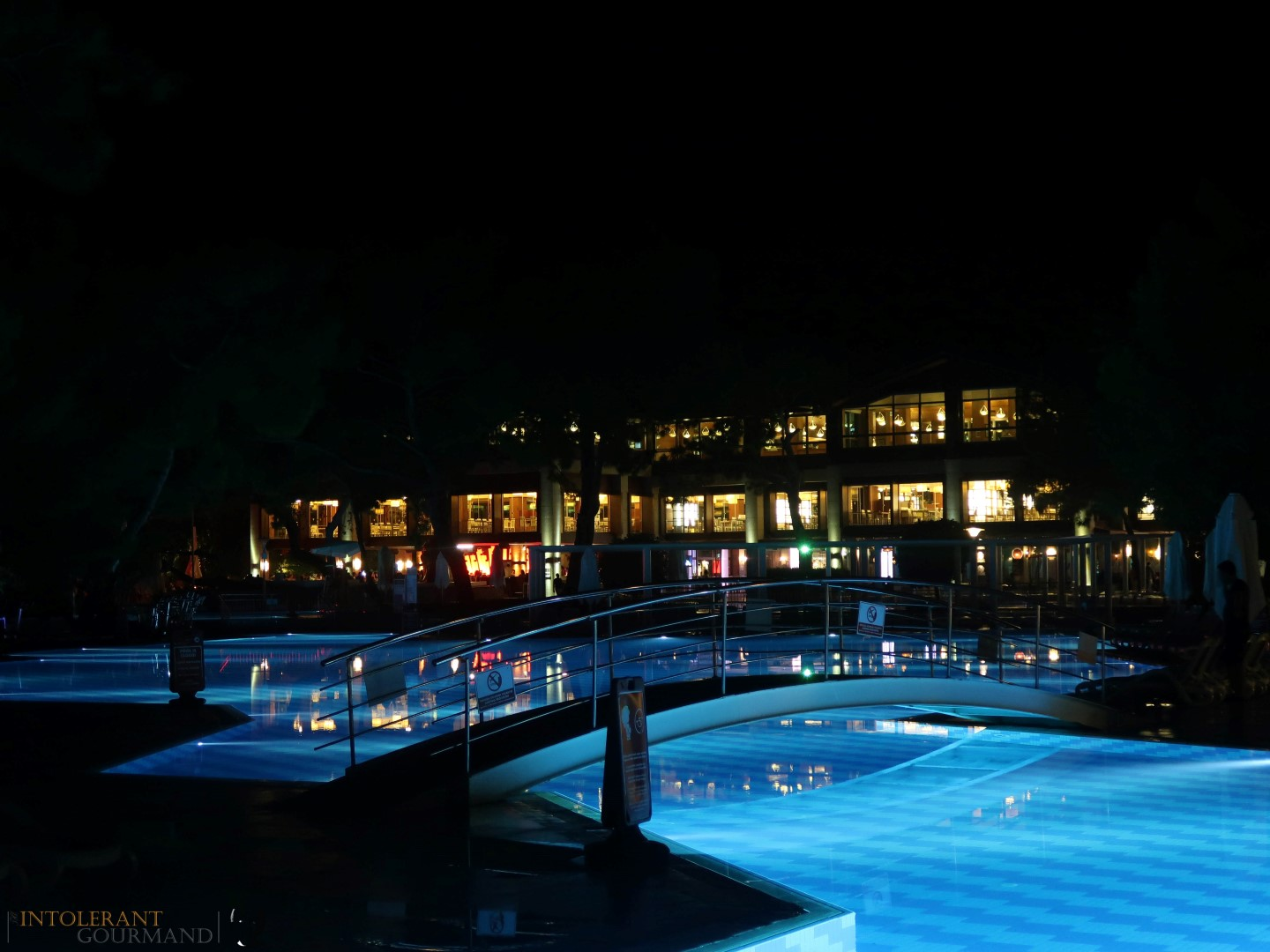 Rixos Sungate Kemer Antalya with Jet 2 Holidays - hotel at night, lights under the swimming pool. www.intolerantgourmand.com