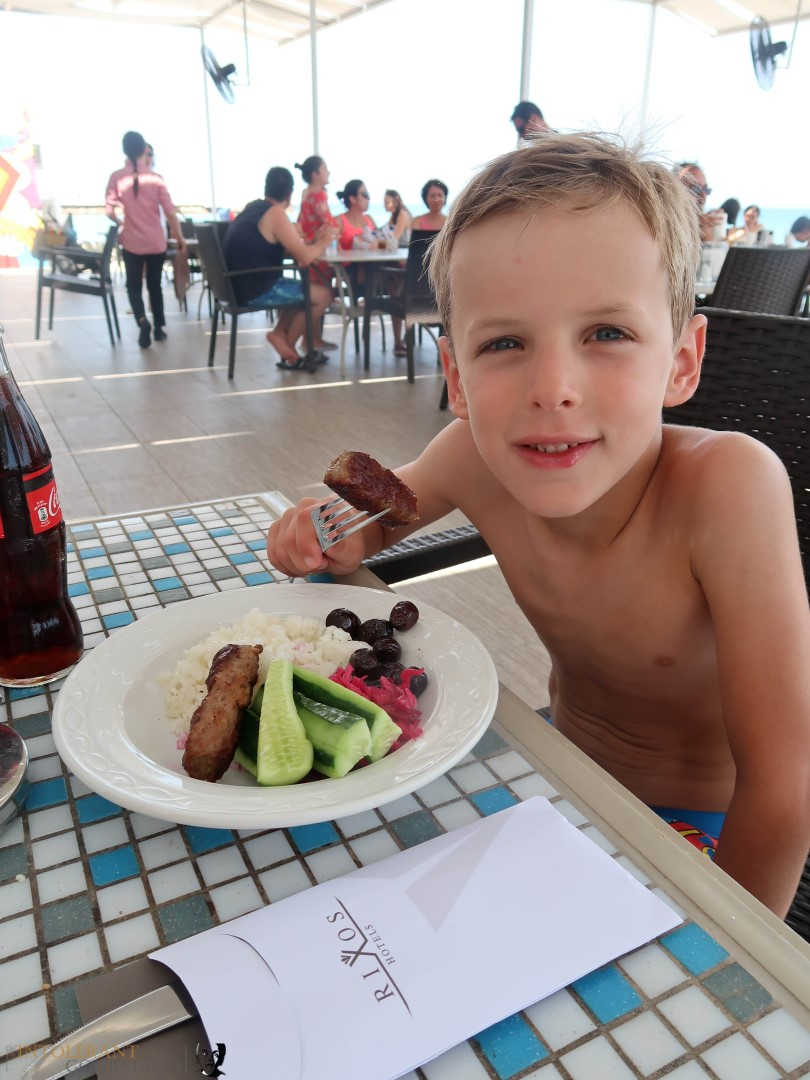 Rixos Sungate Kemer Antalya with Jet 2 Holidays - little boy eating lunch, salad on a plate, restaurant on the beach. www.intolerantgourmand.com